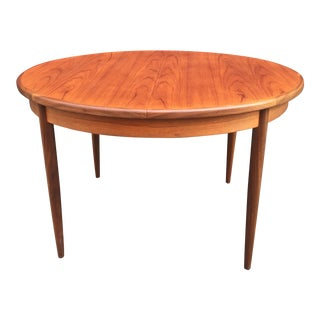 Mid Century Modern Teak Round / Oval Dining Table With 1 Pop Up Leaf For Sale