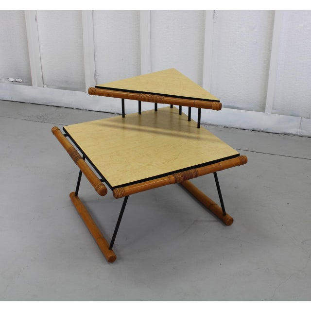 Unusual design with fun mid-century vibe! This corner table features rattan edging and a black metal frame with light,...