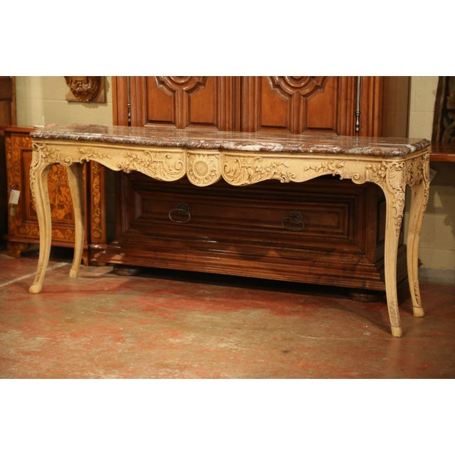 This elegant, antique console was crafted in Lyon, France. Carved of oak, the console table features a serpentine shaped...