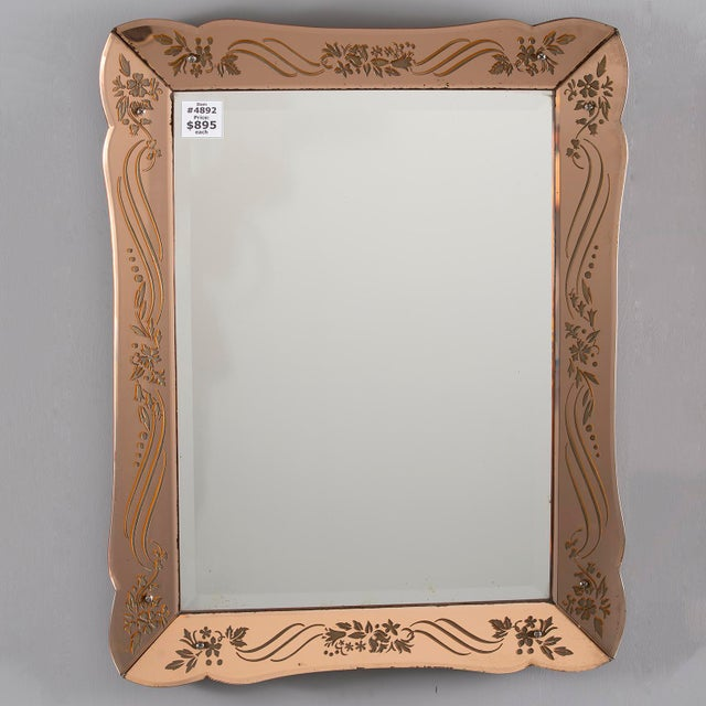 Circa 1930s rectangular Art Deco mirror in pale apricot shade with reverse etched details on frame. Found in France....