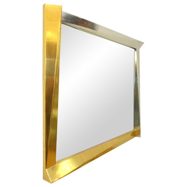 A fantastic, cubist, giltwood-framed mirror. A wonderful, optically-alluring geometric frame playfully jutting out of its...
