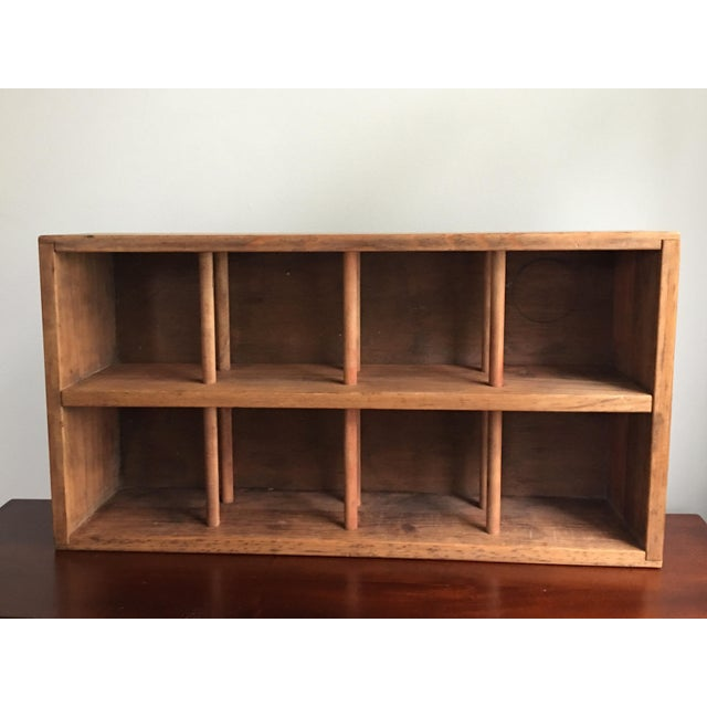 Mid-century wooden wine crate, beautifully weathered patina, with places for 8 upright bottles of wine to be stored and...