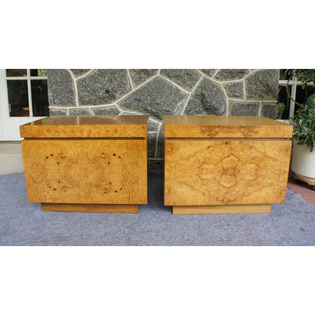 A pair of glam nightstands in book matched olivewood burl veneer, designed by Milo Baughman for Lane Furniture circa...