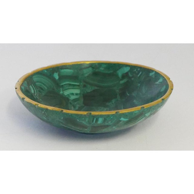 Gorgeous, polished malachite dish with brass trim. The swirls become architectural. Unique mid-late 20th century piece....