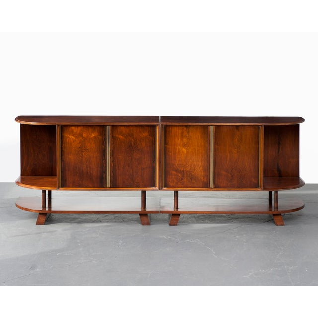 Two-piece credenza in jacaranda with four doors and curved sides. Brazil, 1950s. The design attributed to Joaquim Tenreiro