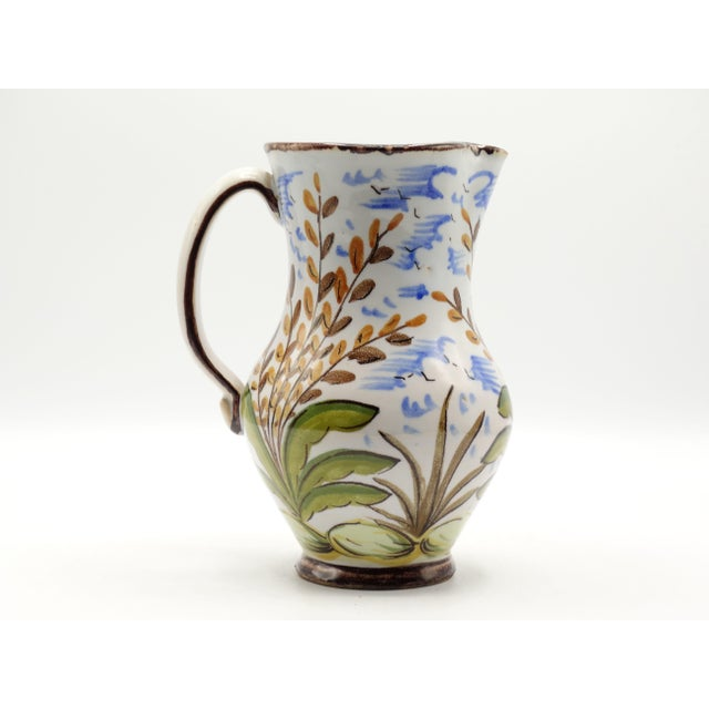 Lovely antique French faience pitcher hand painted and hand thrown. It has a delightful bird, wheat stock, and is accented...