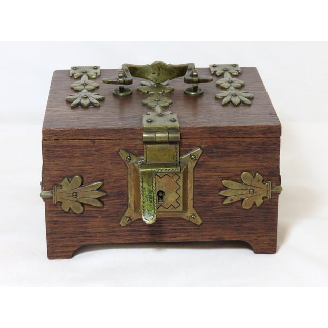 A fine quality hand made oak lock box with heavy cast solid bronze hardware. Interior has its original red velvet lining....