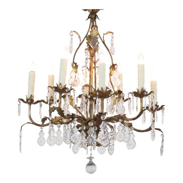 An elegant Italian 1960's Hollywood regency 8-light gilt-tole chandelier For Sale