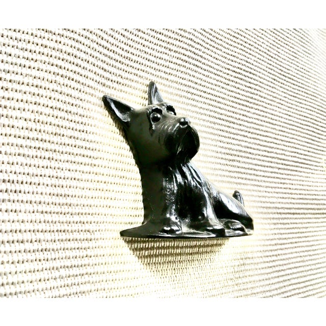 We love this little Scottie and his inquisitive expression! Vintage cast iron Scottish Terrier doorstop or bookend. We'd...