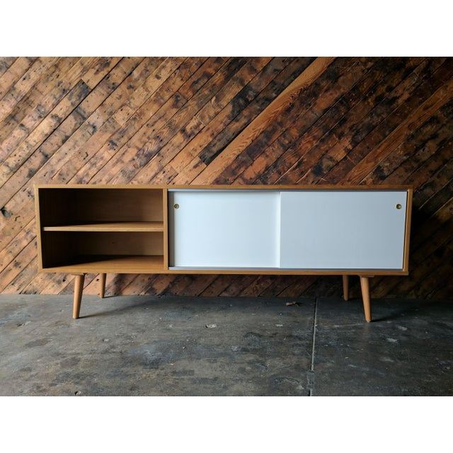 Off white sliding doors with aluminum track. Adjustable open shelf on the left and behind sliding doors. W:72 D:16.25...