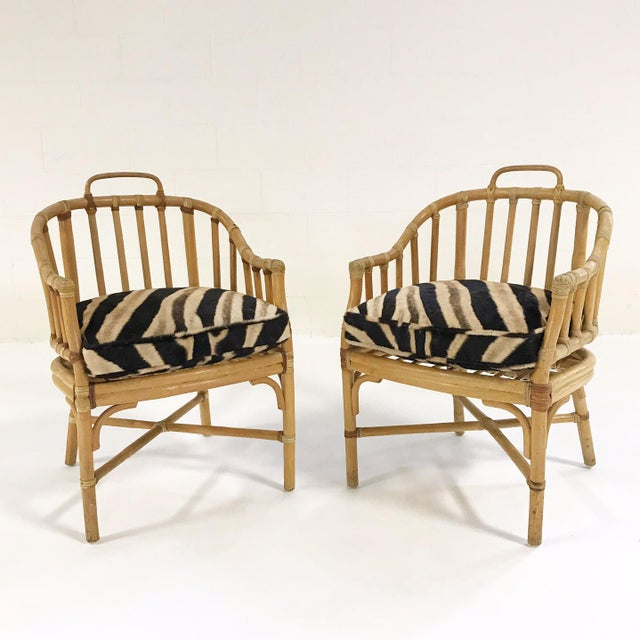 "Simply charming. We adore this little pair of rattan armchairs. Perfect for the sunroom! 23"" W x 18.5"" D x 33.5"" H x 19""..."