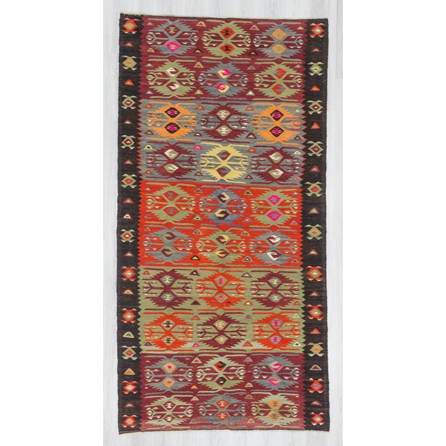 Handwoven vintage colorful kilim rug from Afyon region of Turkey. In good condition. Approximately 45-55 years old.