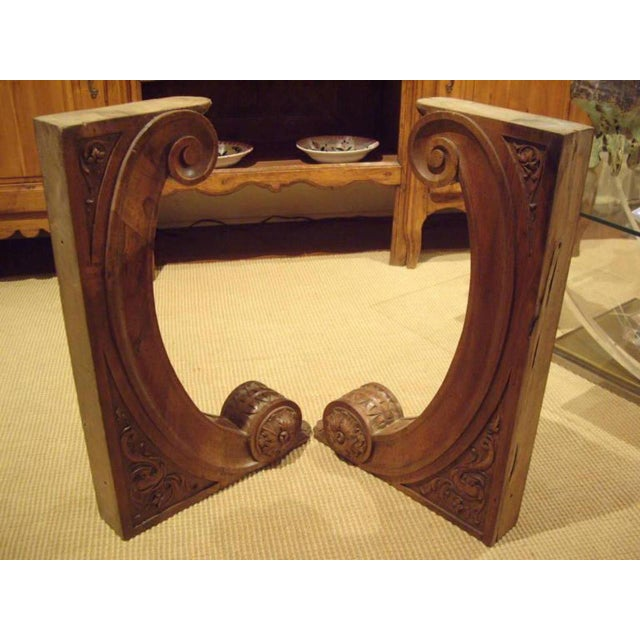 Pair of beautifully carved solid walnut Italian 19th century architectural brackets. Circa 1890.