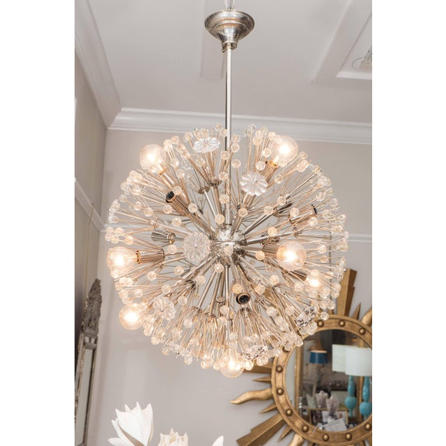 This beauty will light up the room! The sputnik ceiling fixture has twelve lights and is accented with round glass faceted...