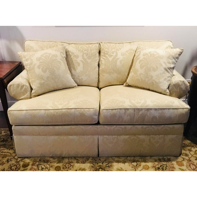 A tried and true Ethan Allen classic, this comfortable sofa/loveseat features clean lines and an inviting cushioned back...