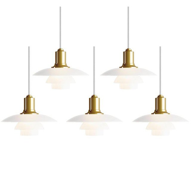 *NOTE: 2-3 WEEK LEAD TIME* Poul Henningsen PH 2/1 brass and glass pendants for Louis Poulsen. Executed in white opal glass...