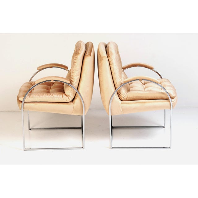 Milo Baughman-style side chairs in thin-line polished chrome, newly reupholstered in a subtle, blush champagne low-pile...