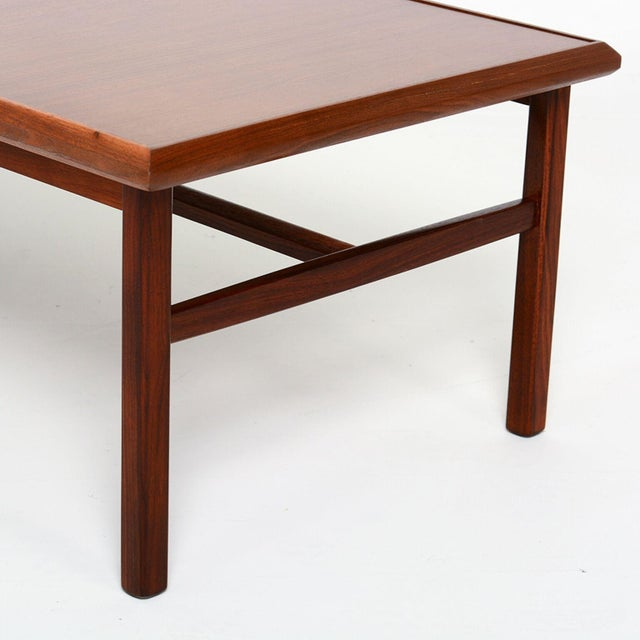 For your consideration: a vintage coffee table in walnut wood. Legs and sides of the tabletop are made of solid walnut....