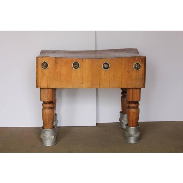 Unusual antique American butcher block table with adjustable height.