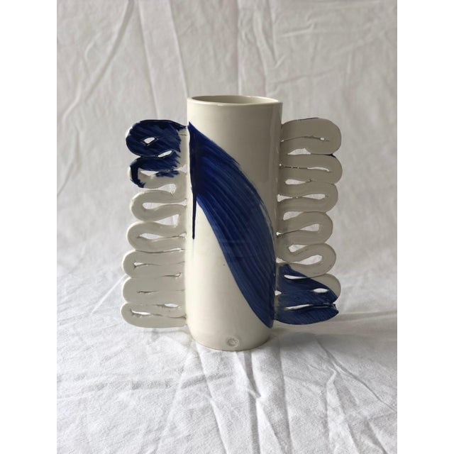 This unique cylindrical porcelain vessel is finished with my signature flattened handles. The surface is treated like a...