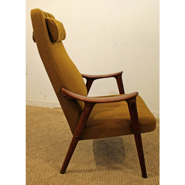 What a find. Offered is a Mid-Century modern arm/lounge chair. It is made of teak with a removable, weighted headrest,...