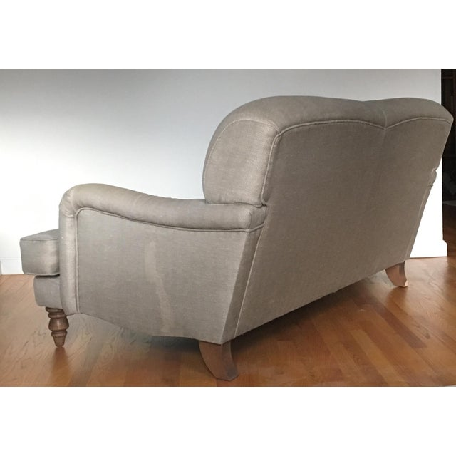 This is the Snowdrop Two-Seat sofa in the clay herringbone upholstery. I bought this sofa when I lived in London, England...