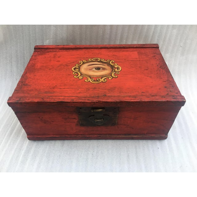 Fantastic old Chinese lacquer red wood box with metal closure and painted Victorian eye cameo on the lid. A great...