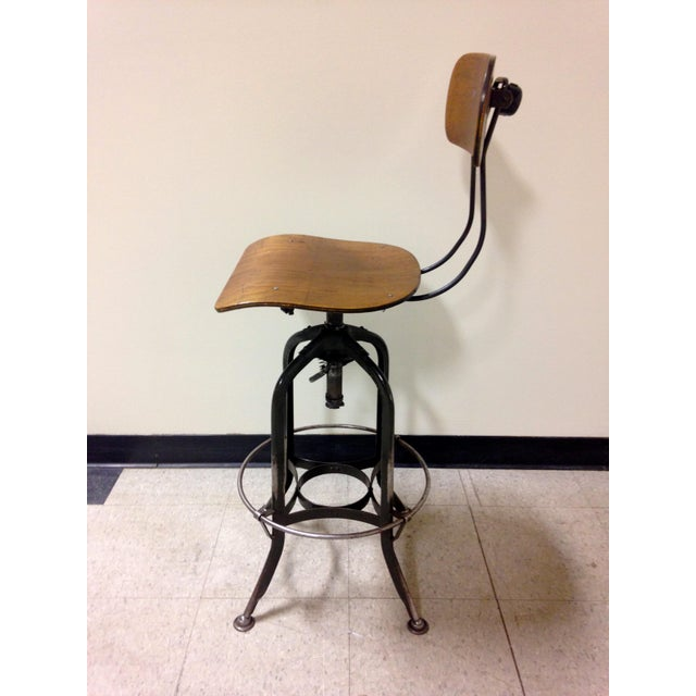 Excellent Toledo Metal Furniture Company bent plywood seat and back with distressed grey painted steel frame. Back rest...