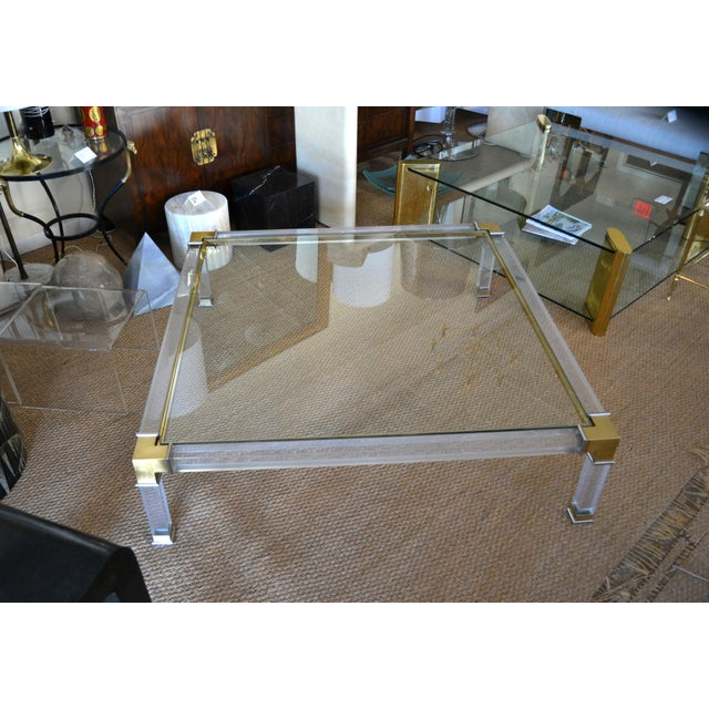 Early monumental lovely Hollywood Regency square Acrylic, Bronze Glass coffee table with Chrome details by Charles Hollis...