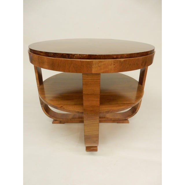 Northern European Art Deco round walnut side table. The table has been restored and is structurally sound. Because of...