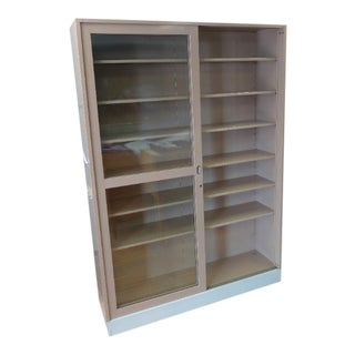 Storage Shelving Unit of Painted Steel With Sliding Glass Doors, Adjustable Shelves, Circa 1970s. For Sale