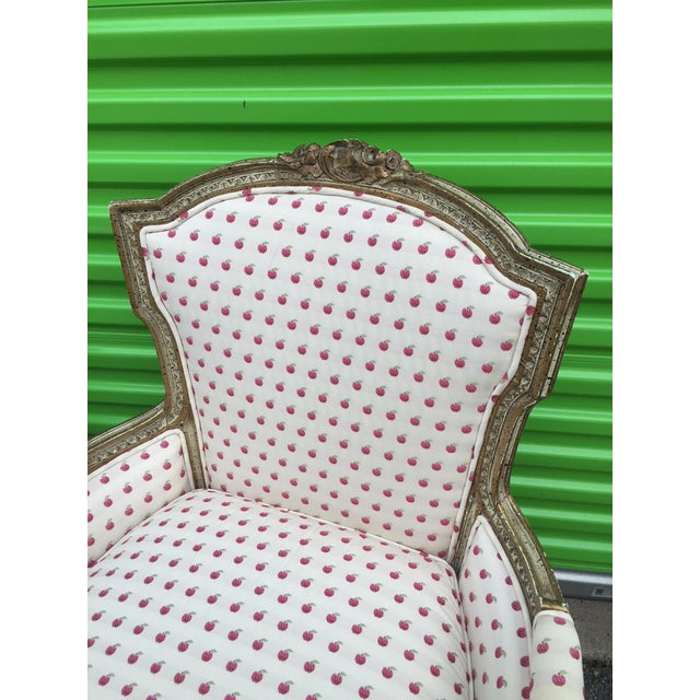 Pair of paint decorated 1950's French style Berger chairs upholstered in apple fabric. Beautiful pair of arm chair.