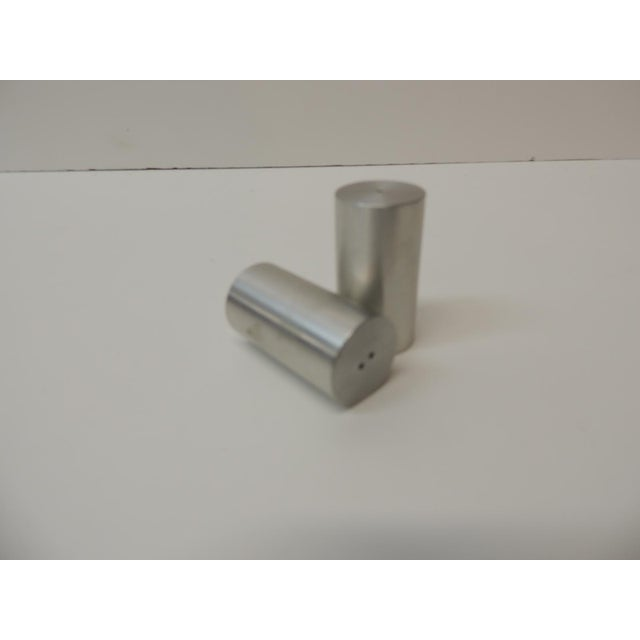 """Tubular chrome round salt and pepper shakers Stamped: Made in the U.S.A. by Zanazar Size: 1"""" D x 2"""" H."""