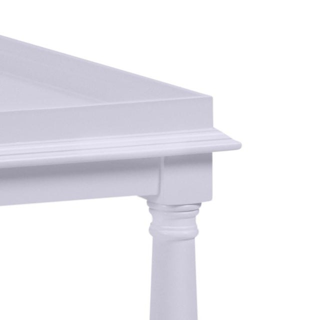 Made of acacia wood, this cocktail table features a gallery shelf and turned legs. Color is Benjamin Moore North Cascades...
