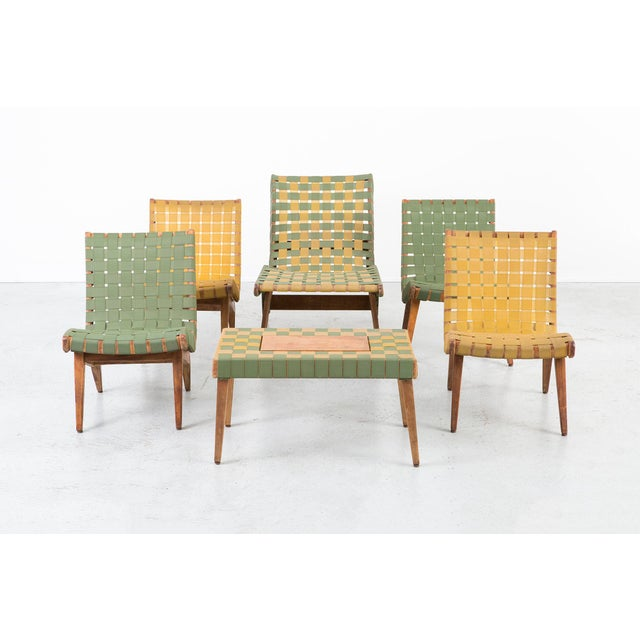 A furniture set that consists of two rocking lounge chairs, two lounge chairs, one lounge chaise, and one side table....