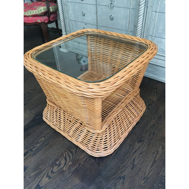 Vintage rattan / wicker side or end table with glass top with thick honey colored woven reeds on bamboo frame. The table...