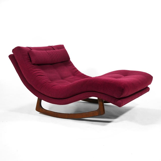 A large and incredibly comfortable chaise with a sculptural walnut base that allows it to rock gently, this design by...