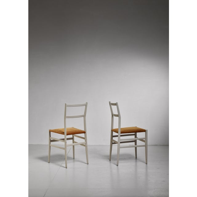 A pair of model 646 'Leggera' ('light') chairs by Italian architect and designer Gio Ponti in a as rare as beautiful grey...