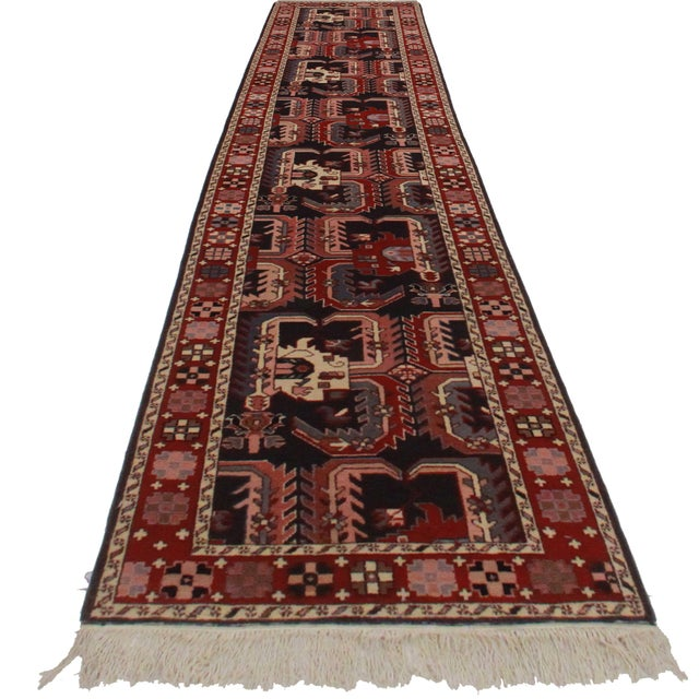Hand knotted wool runner with a beautiful Asian style motif. This classic piece works with virtually any decor scheme in...