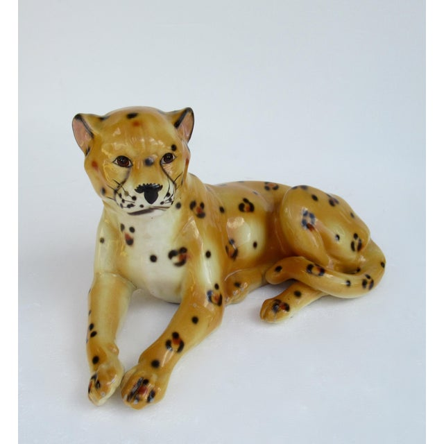 Vintage; Hollywood Regency, Italian porcelain ceramic, hand-painted leopard in a relaxed, repose position. There are a...