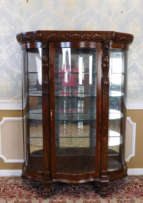 Delightful Oak Antique Victorian Carved Figural Quartered Oak Curved Glass Curio  Cabinet C1900 For Sale   Image