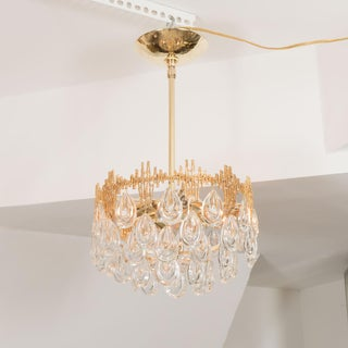 1960s Mid-Century Modern Three Tier Brass and Crystal Drop Lens Chandelier Preview