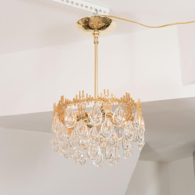 Small three tier brass chandelier composed of crystal lens drops by Palwa.