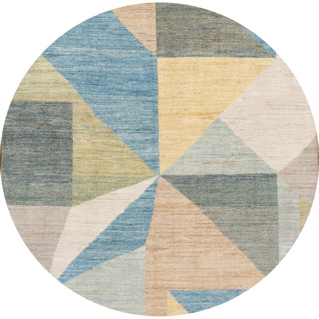 Beautiful contemporary deco rug, hand-knotted wool with an ivory field, multi-color accents (blue, green, yellow and tan)...