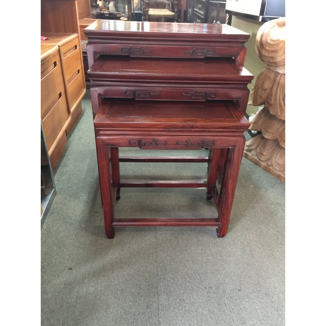 """Fantastic set of rosewood nesting tables, circa 1970, with carved borders. The tables measure, large table 24"""" wide x 14""""..."""