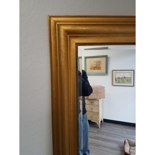 "This is a nice gold colored beveled mirror. It can be hung either vertically or horizontally. Measurements = 31.5""x 71"" x..."