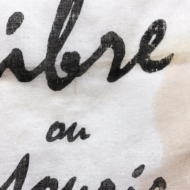 """This delicate antique bunting has been newly embellished with a phrase from the French Revolution, """"Vivre Libre ou Mourir""""..."""