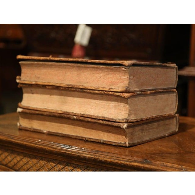 Decorate a library or an office with these three large antique law books. Dated respectively 1692, 1699 and 1700, these...