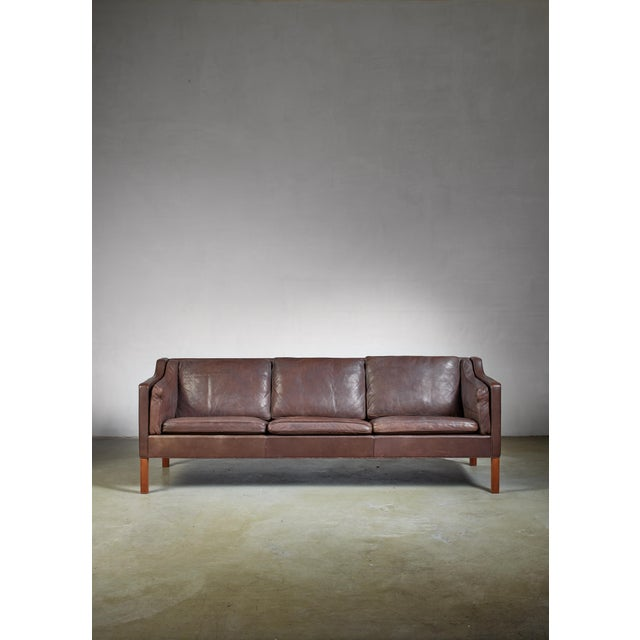 A dark brown leather model 2213 three seater sofa by Børge Mogensen for Fredericia, Denmark. The leather is softened from...