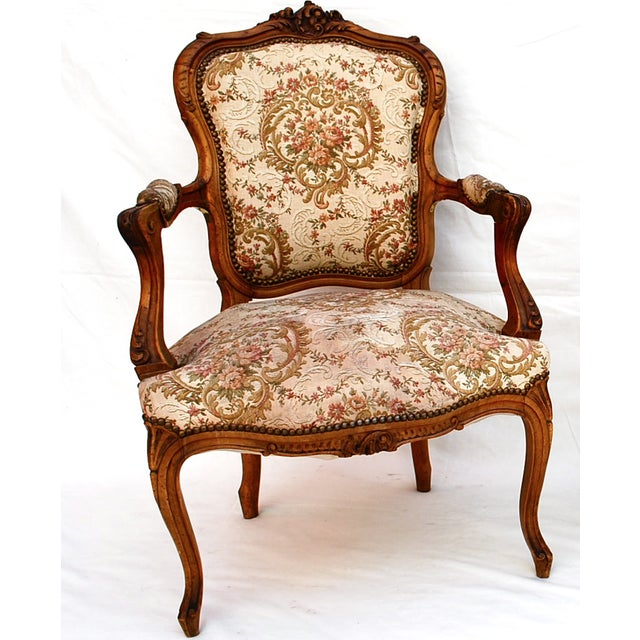 An elegant pair of bergere with tapestry fabric, we have also one more pair with out the arms.